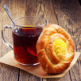 Bun with custard and tea Royalty Free Stock Images