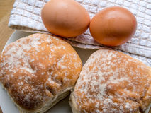Bun and eggs Royalty Free Stock Images