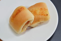 Bun filling bacon and cheese on dish Royalty Free Stock Photos