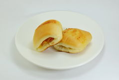 Bun filling bacon and cheese on dish Royalty Free Stock Photography