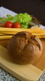 Bun. Fresh roll from rye bread, breakfast preparation Stock Images