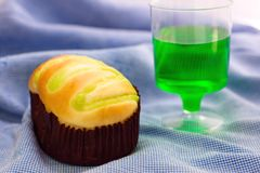 Bun and Green fruit flavor soft drink. On blue cloth stock photos