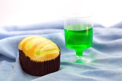 Bun and Green fruit flavor soft drink. On the blue fabric stock images