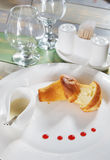 Bun with jam in a plate on the served table Royalty Free Stock Photography