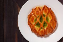 Bun with kiwi jam on white plate Royalty Free Stock Images
