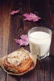 Bun and milk Stock Images