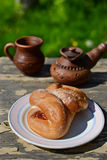 Bun on old wooden table. Bun and tea on old wooden table Royalty Free Stock Photography
