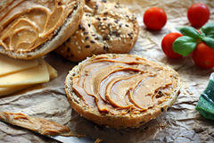 Bun with peanut butter. Healthy sandwich made of wholegrain bread roll and peanut spread Royalty Free Stock Photography
