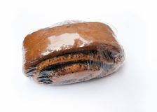 Bun with poppy seeds. In plastic packaging on white background Stock Images
