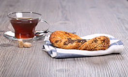 Bun with poppy seeds and teacup Stock Photography