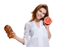 Bun with poppy seeds vs grapefruit, healthy food concept Stock Photography