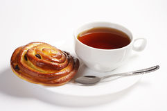 Bun with raisins and tea Stock Image