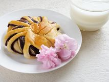 Bun with red bean paste. Freshly baked bun with red bean paste with a glass of low fat milk, healthy breakfast combinations Stock Image