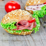 Bun with salami Stock Images