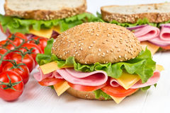 Bun and sandwiches with ham snd cheese Stock Photo