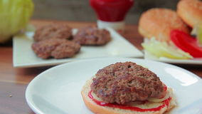 Bun with sauce and onions. Stacked burger stock footage