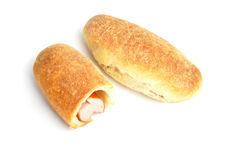 Bun with sausage on white background Stock Images