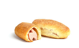 Bun with sausage on white background Royalty Free Stock Photo