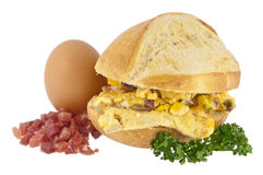 Bun with scrambled eggs and ingredients Royalty Free Stock Image