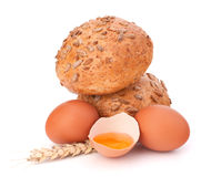 Bun with seeds and broken egg Stock Image