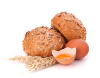Bun with seeds and broken egg Royalty Free Stock Images