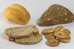 Bun with seeds, white bun, two slices of bread Royalty Free Stock Images
