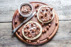 Bun slices with chocolate cream and nuts Stock Photos
