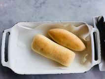 Bread. A bun is a small, sometimes sweet, bread, or bread roll. Though they come in many shapes and sizes, they are most commonly hand-sized or smaller, with a Royalty Free Stock Photography