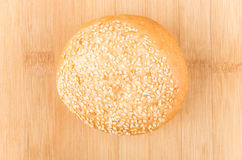 Bun sprinkled with sesame seeds on bamboo board Stock Photography