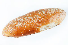 Bun sprinkled with sesame seeds on a light background. insulatio Royalty Free Stock Image