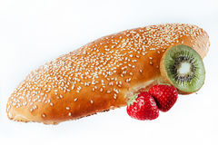 Bun sprinkled with sesame seeds on a light background. insulatio Stock Photos