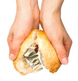 Bun stuffed with money Stock Photo