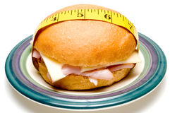Bun with tape measure Royalty Free Stock Photo