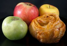 Bun with three apples Stock Images
