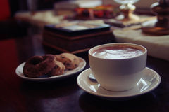 Bun and сup of hot chocolate drink Stock Images