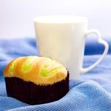 Bun and white coffee mug Stock Photos
