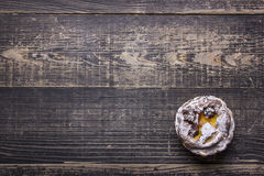 Bun on the wooden background. Delicious bun on the wooden background.  flat lay Royalty Free Stock Images