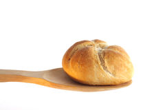 Bun on a wooden spoon Royalty Free Stock Images