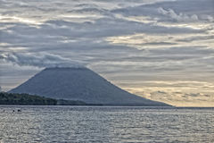 Bunaken Volcano at sunset on tropical paradise island Stock Photography