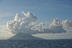 Bunaken Volcano on turquoise tropical waters Royalty Free Stock Photography