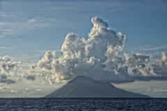 Bunaken Volcano on turquoise tropical waters Royalty Free Stock Image