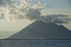 Bunaken Volcano on turquoise tropical waters Stock Photo