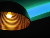 Bunb and neon in the night club. Yellow bunb and turquoise neon in the night club royalty free stock photo