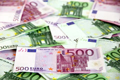 Bunch of 100 and 500 euro banknotes (messy). Messy bunch of 100 and 500 euro banknotes on white background (European Union Royalty Free Stock Image