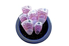 Bunch of 500 Euro notes growing in a pot Royalty Free Stock Photos