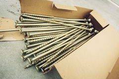 Bunch anodized long screws for construction of houses Royalty Free Stock Image