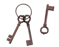 A bunch of antique keys and one single key Royalty Free Stock Photography