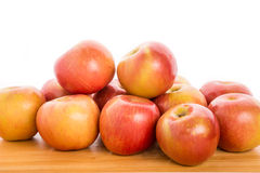 Bunch of Apples on Wood Table with White Background Royalty Free Stock Image