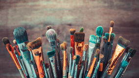 Bunch of artistic paintbrushes. Retro toned. Stock Photo