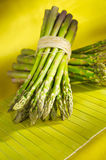 Bunch of asparagus. On yellow background royalty free stock images